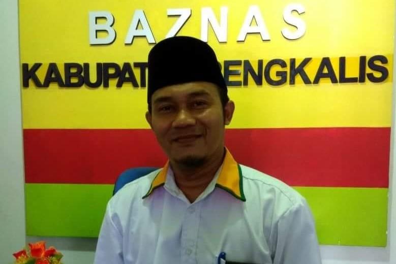 Baznas Kabupaten Bengkalis Salurkan Sumbangan Rp112.734.000 dan 816 Kg Pakaian